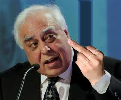 Kapil Sibal in a press conference. photo courtesy: http://demockcrazy.wordpress.com/